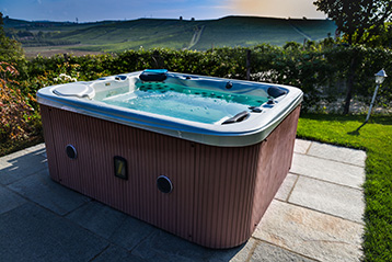 A hot tub in front of a picturesque mountain view